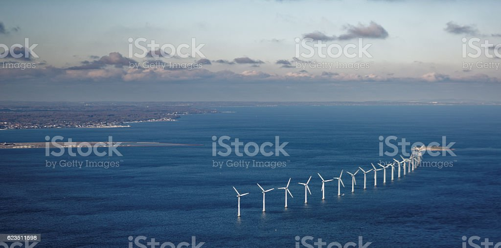 Wind farm in sea stock photo