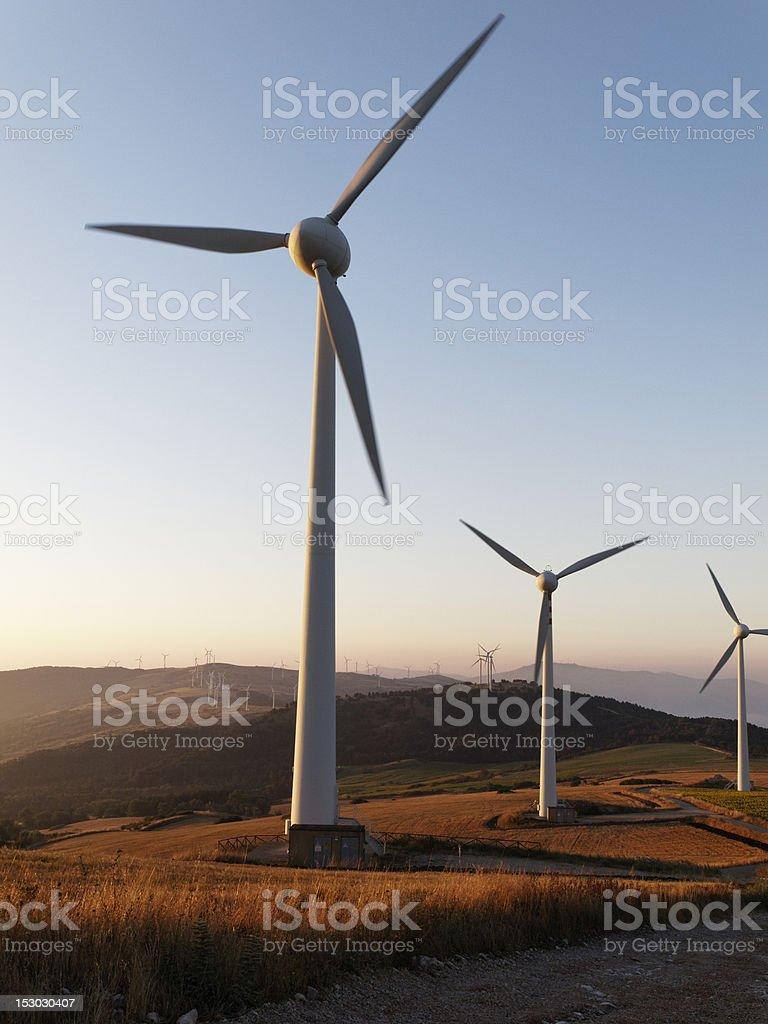 wind farm nature turbines energy electric power sunrise royalty-free stock photo