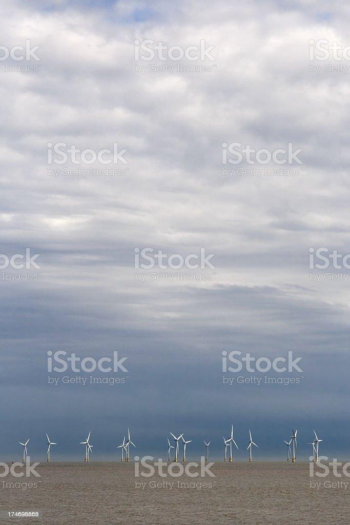 Wind farm off Great Yarmouth beach royalty-free stock photo