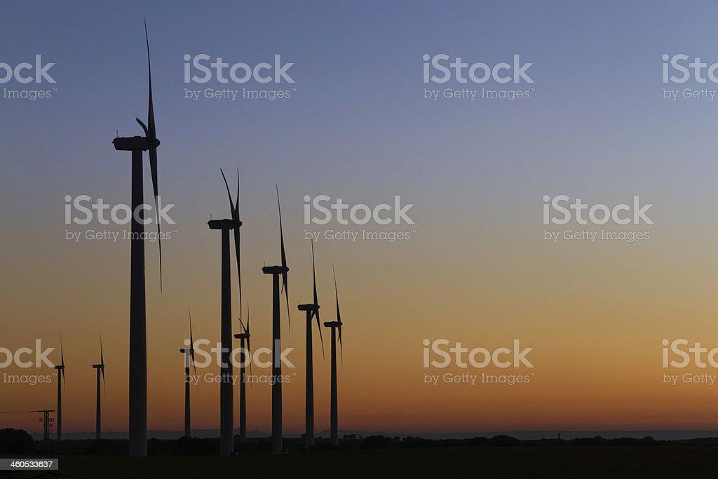 Wind farm on susnet stock photo