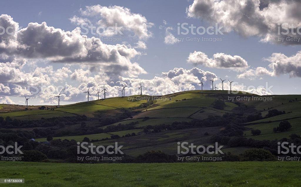 Wind Farm, outline of wind turbines on a Welsh hillside stock photo