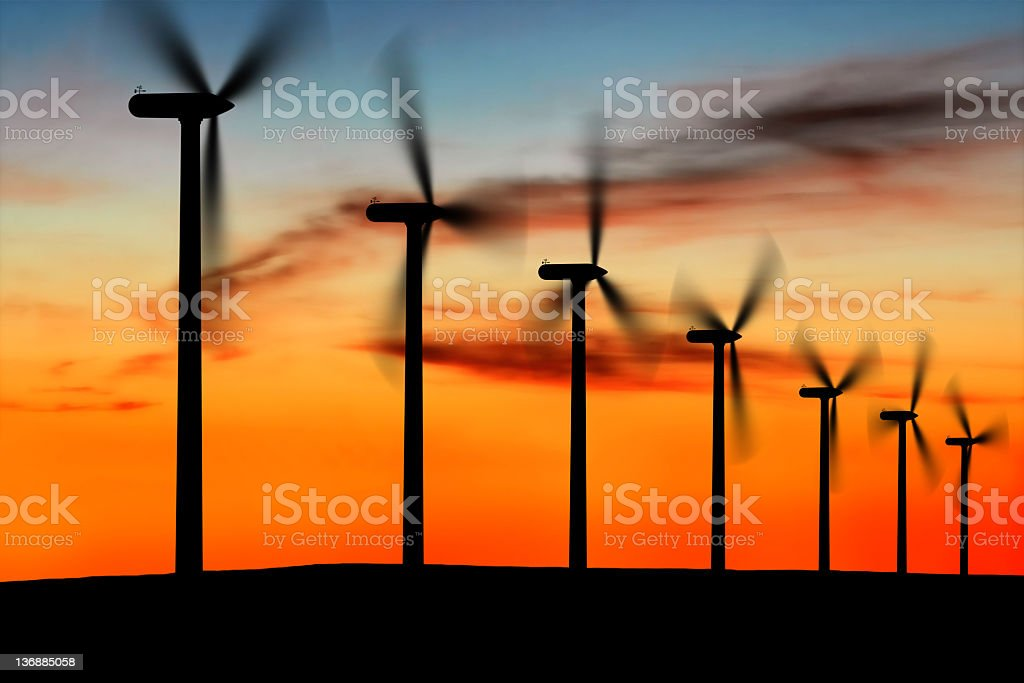 XL wind farm silhouette stock photo