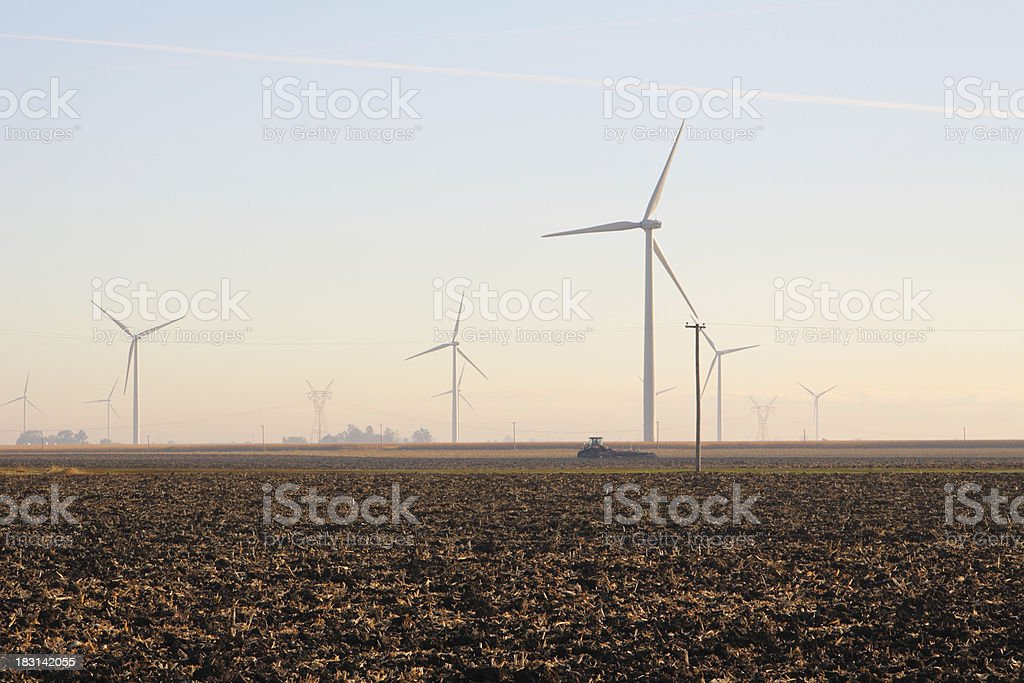 Wind Farm & Tractor Plowing stock photo