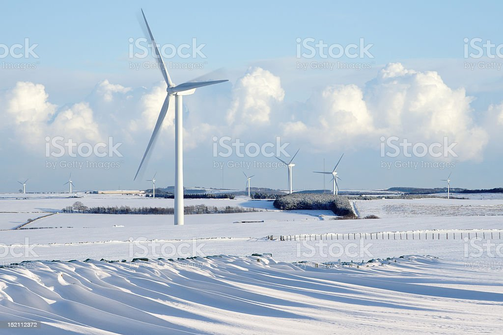 Wind Farm with Snowdrifts royalty-free stock photo