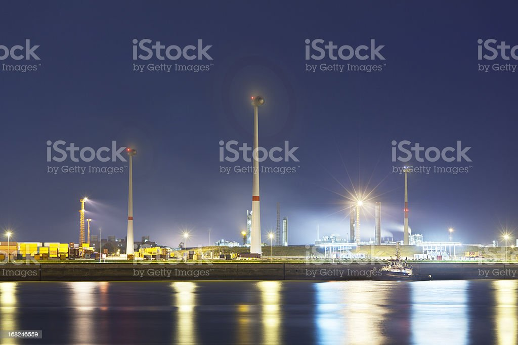Wind Generation In Harbor At Night stock photo
