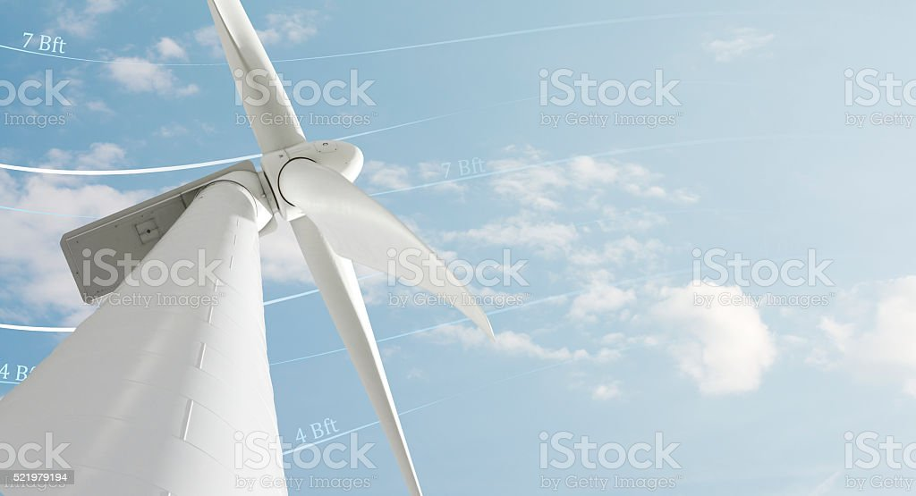 Wind generator against smooth cloudy sky stock photo