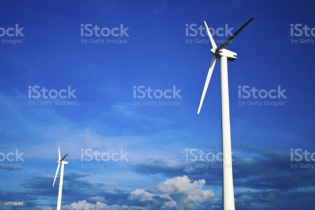 Wind generator in blue sky royalty-free stock photo