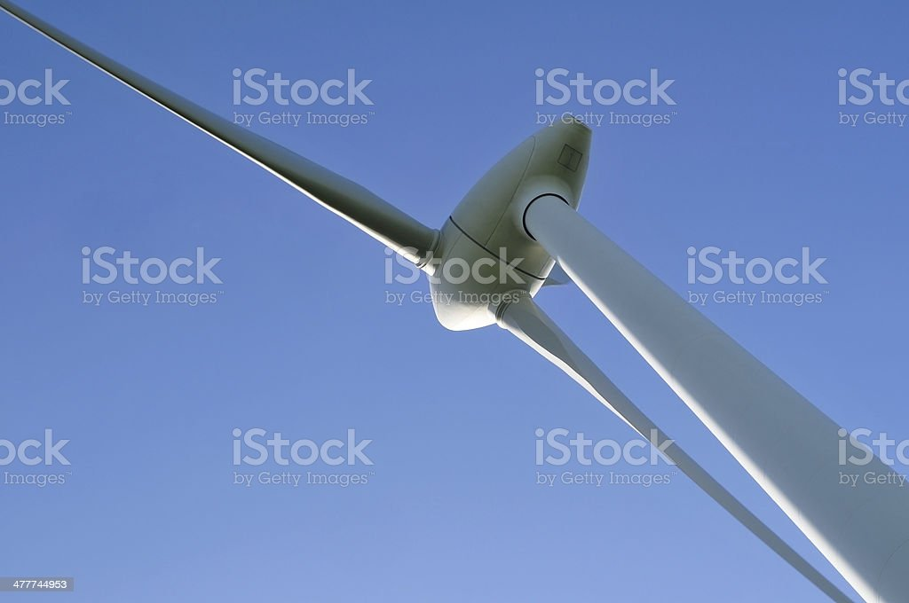 Wind generator in front of a blue sky royalty-free stock photo