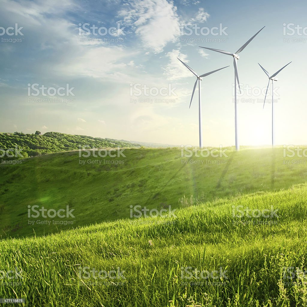 Wind generator turbine on summer landscape stock photo