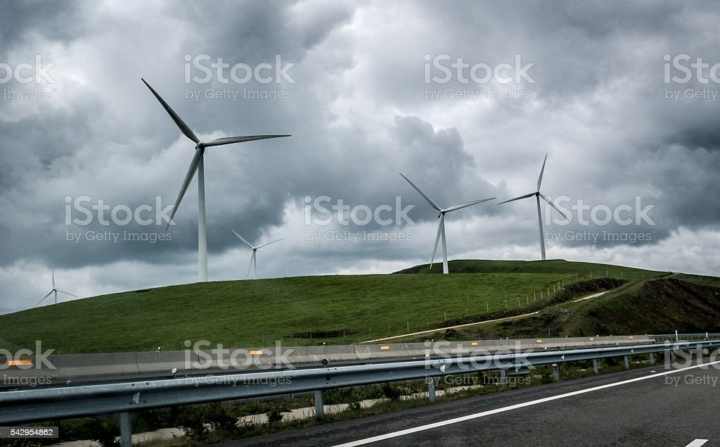 Wind Generators Turbines are generating electricity next to high stock photo