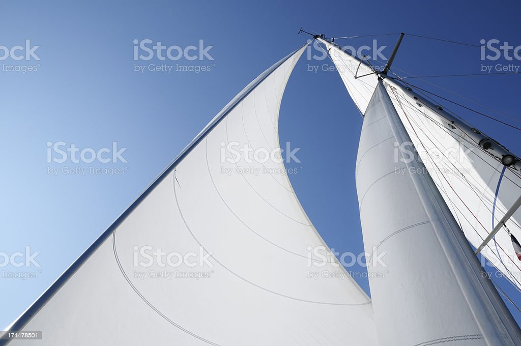 Wind in the sails against blue sky stock photo