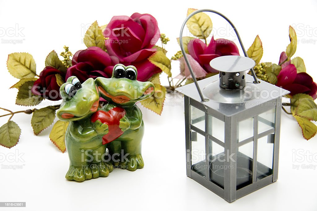 Wind light with frogs and heart royalty-free stock photo