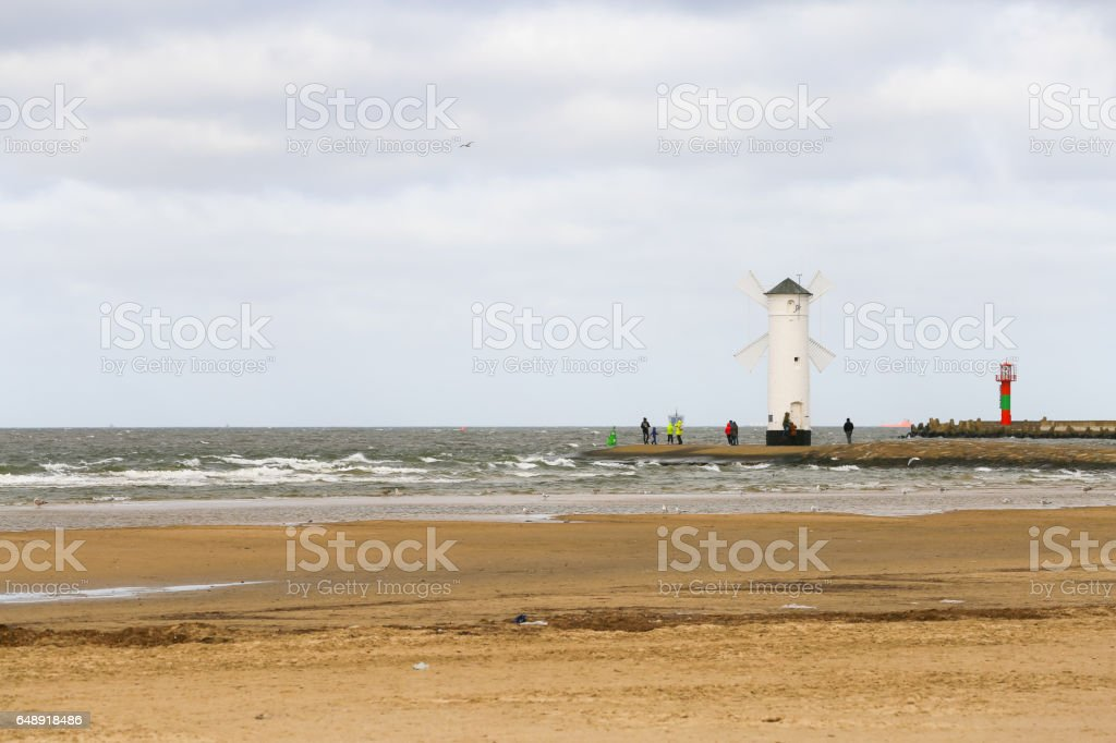 Wind mill at the beach stock photo
