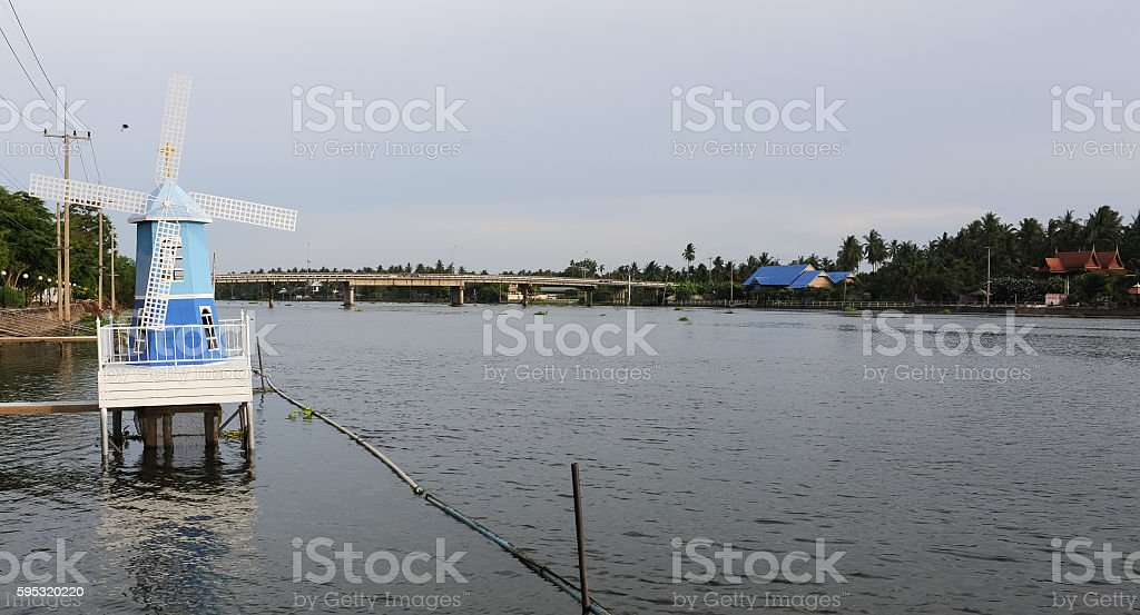 Wind mill in the river. stock photo