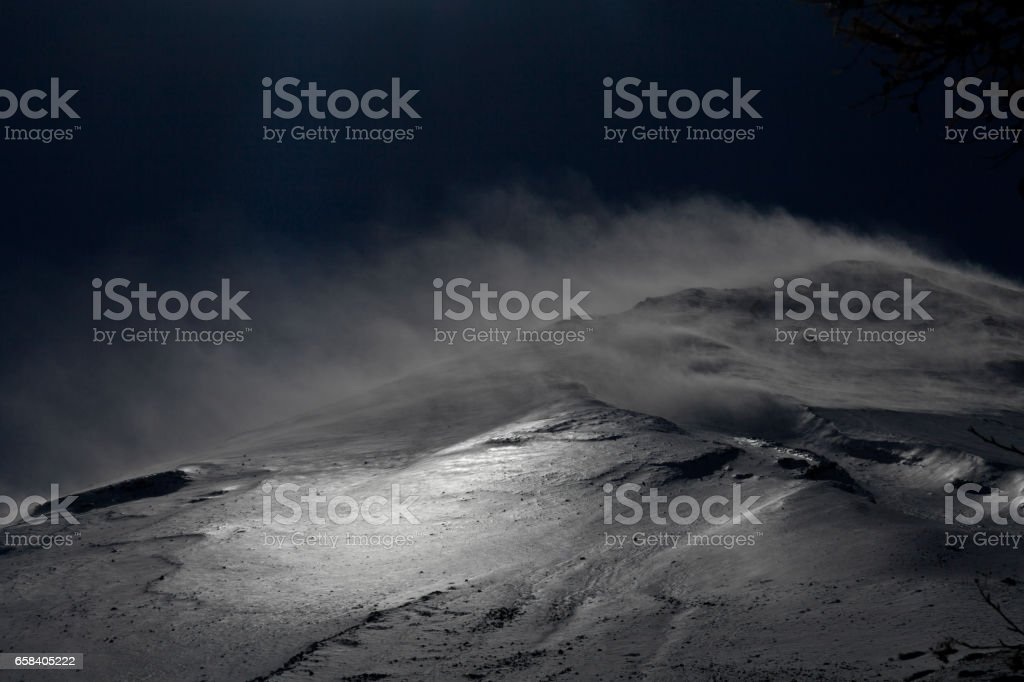 Wind on Mount Fuji with the snow dust stock photo