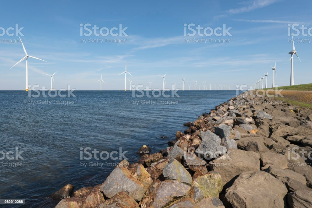 Wind park partly in the water and partly on the land stock photo