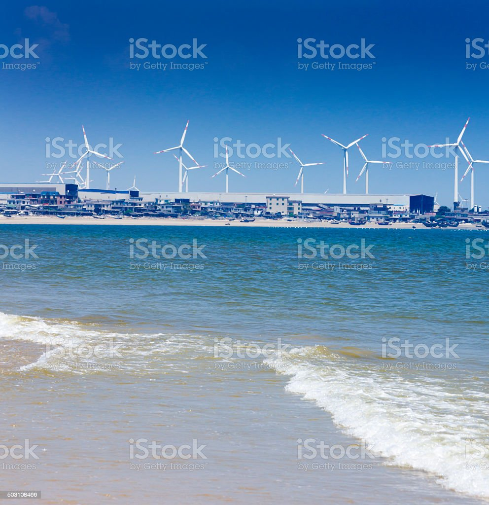Wind power at seaside stock photo