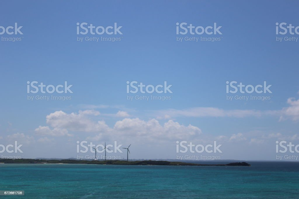 Wind power generators on coral islands in the middle of the ocean. in Miyako island, Okinawa, Japan stock photo