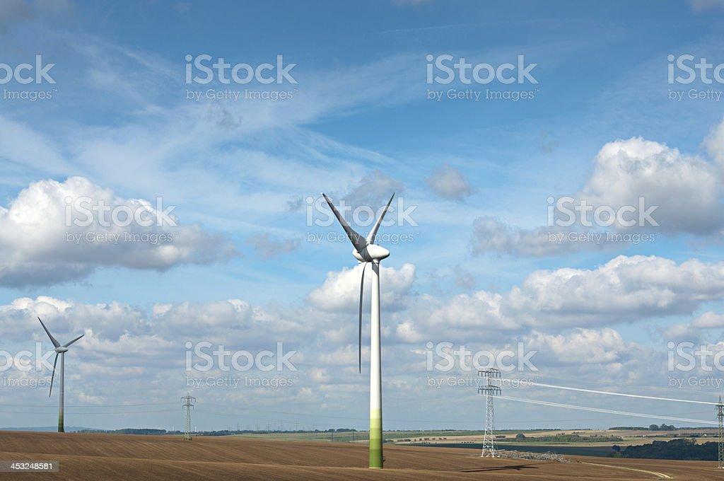Wind power generators on the field. stock photo