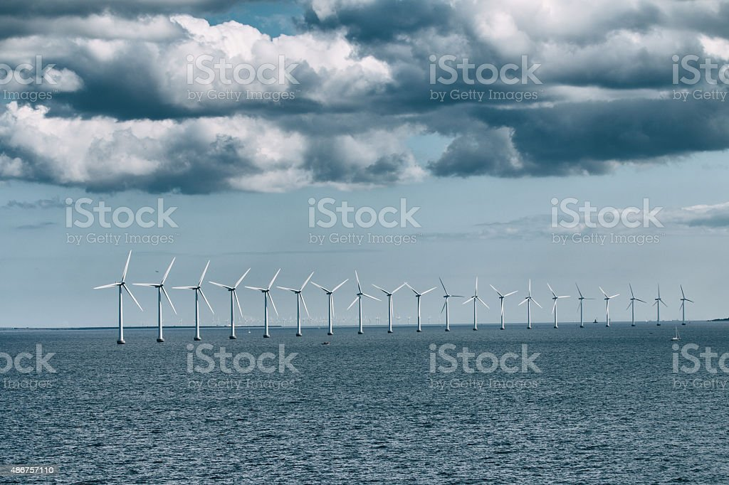 Wind power plant in the sea stock photo