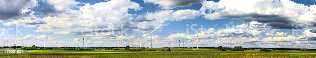 Wind power plants on field panorama royalty-free stock photo
