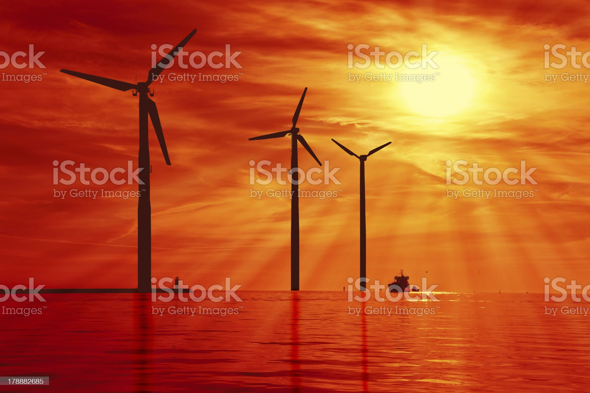Wind power under sunset royalty-free stock photo