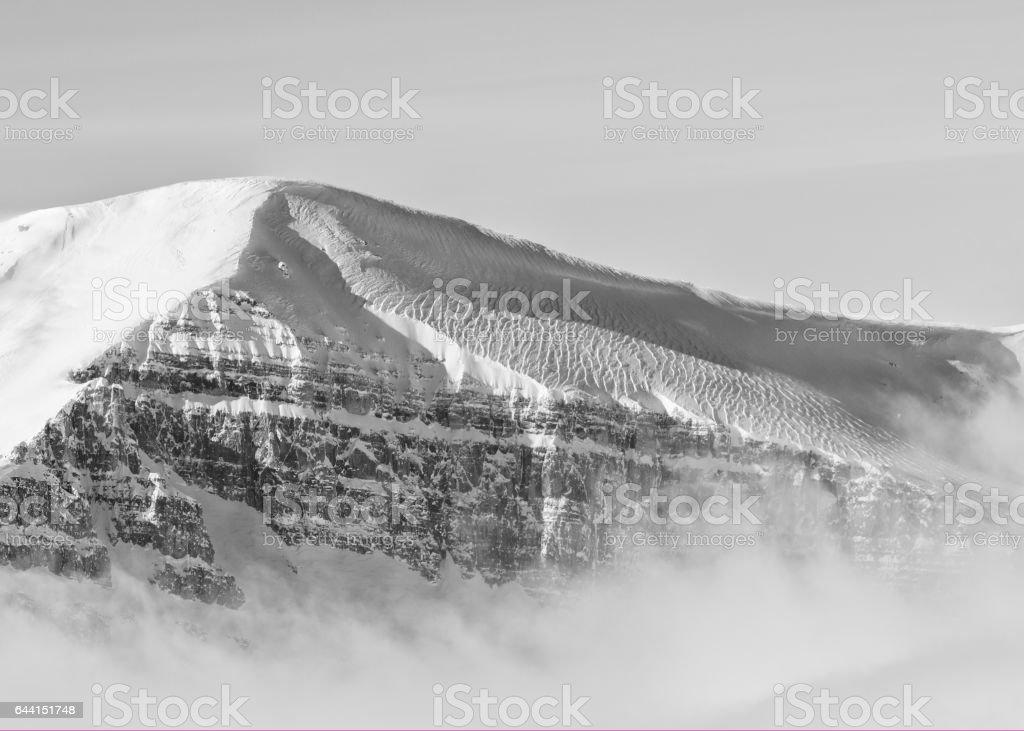 Wind ripple scallops on the snow stock photo