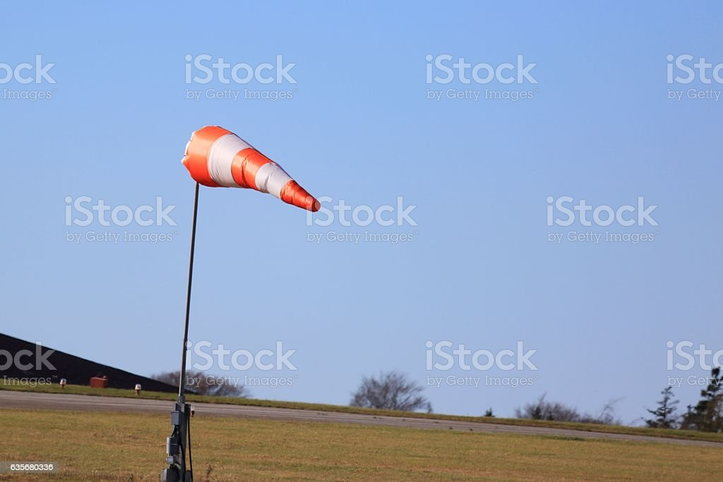 Wind sock direction indicator at an airport stock photo
