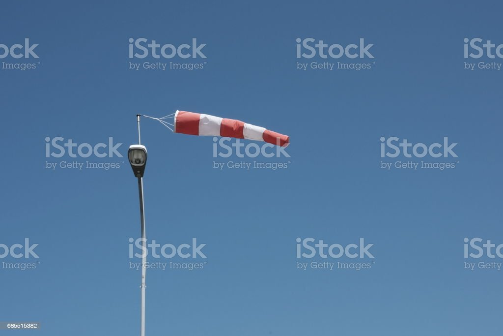 Wind sock in front of blue sky stock photo