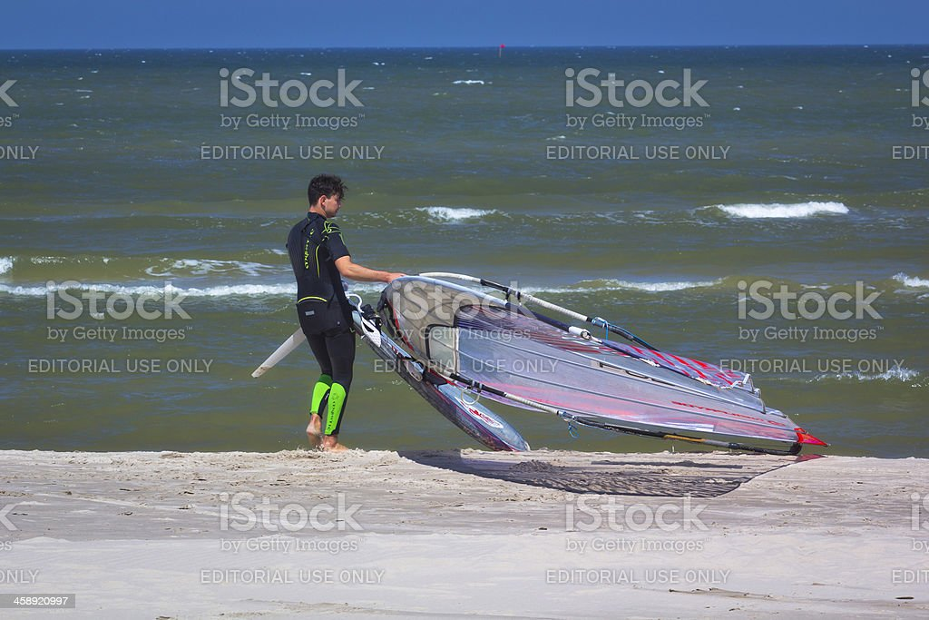Wind surfer on the beach stock photo