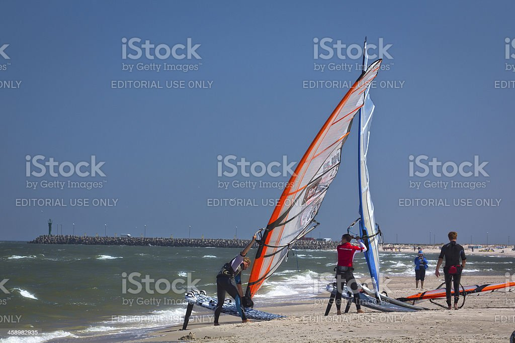 Wind surfers on the beach stock photo