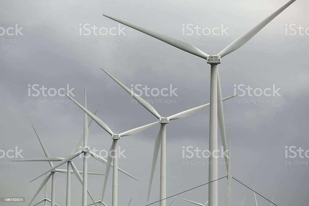 Wind tubines spinning stock photo