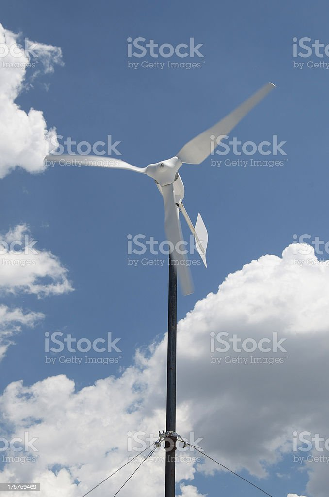 Wind Turbine Against Blue Sky And White Clouds royalty-free stock photo