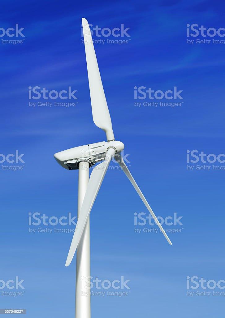 wind turbine against cloudy blue sky stock photo