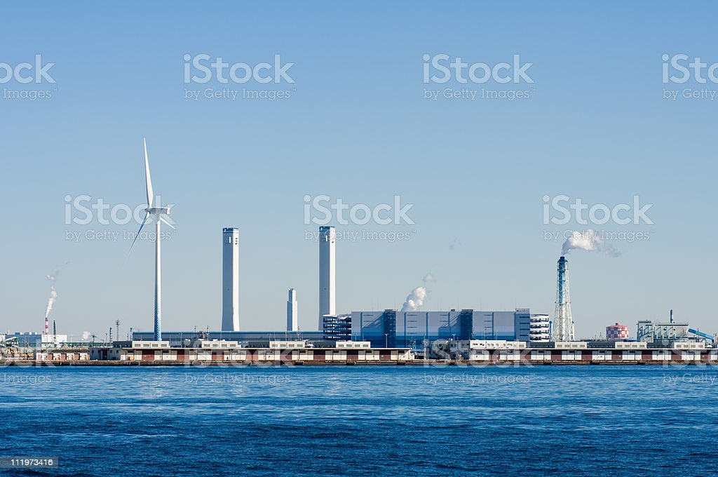 Wind turbine and a thermal power generation stock photo