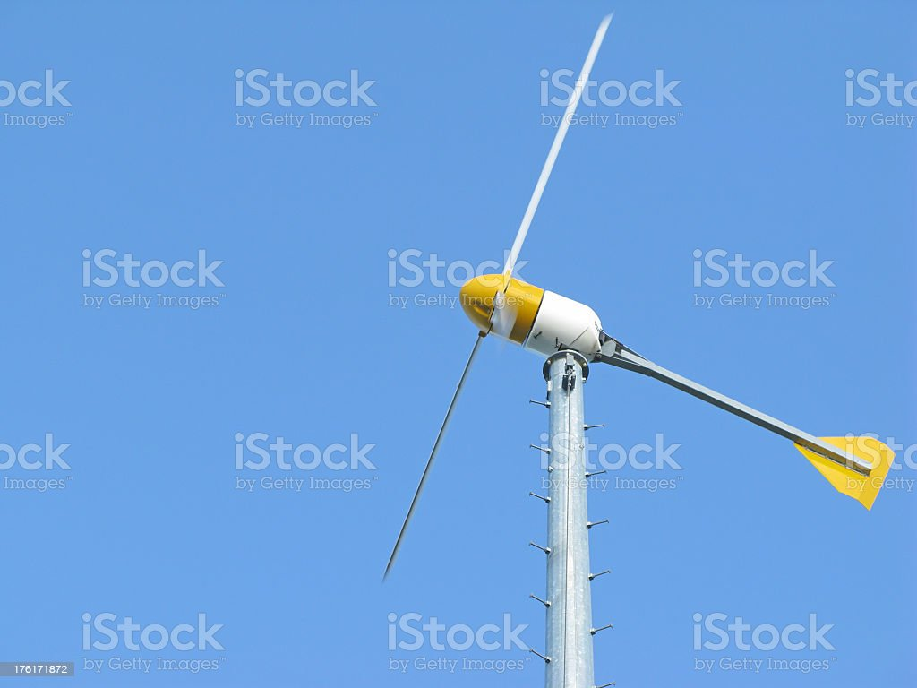 Wind turbine and blue sky with motion blur. stock photo