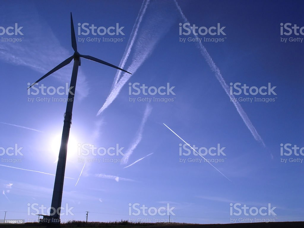 Wind Turbine and Contrails III royalty-free stock photo