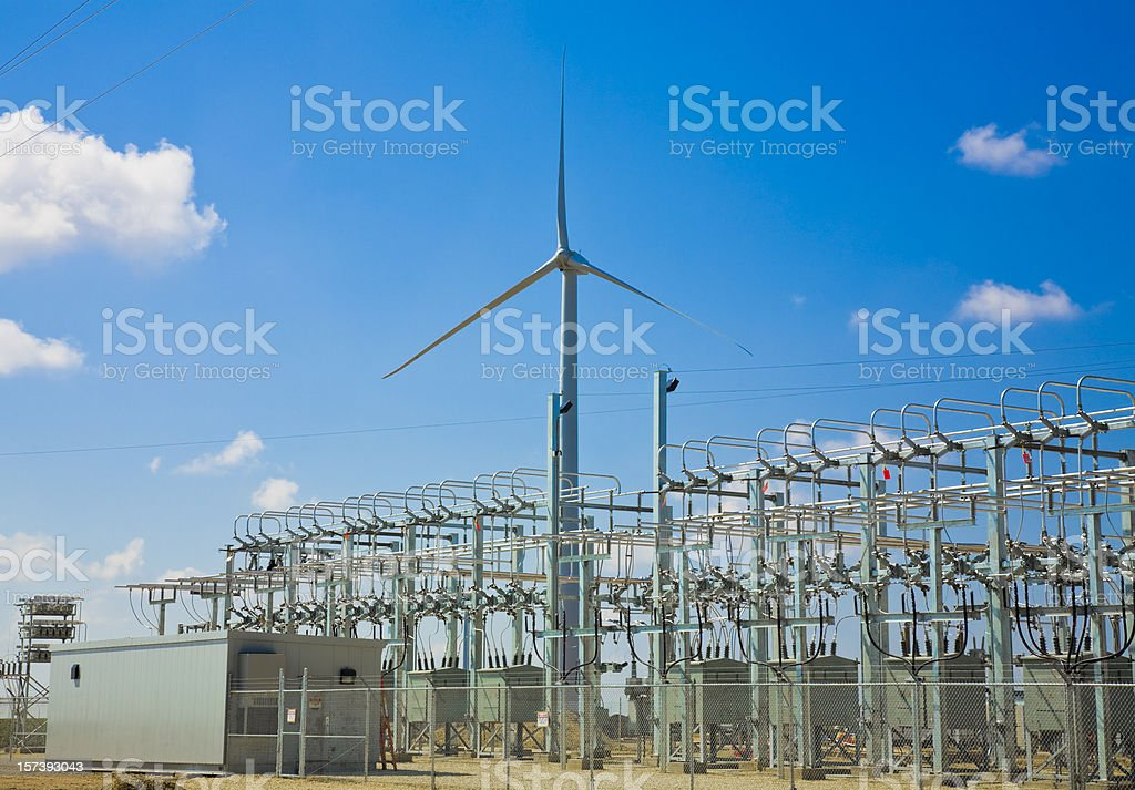 wind turbine and power collection grid substation stock photo