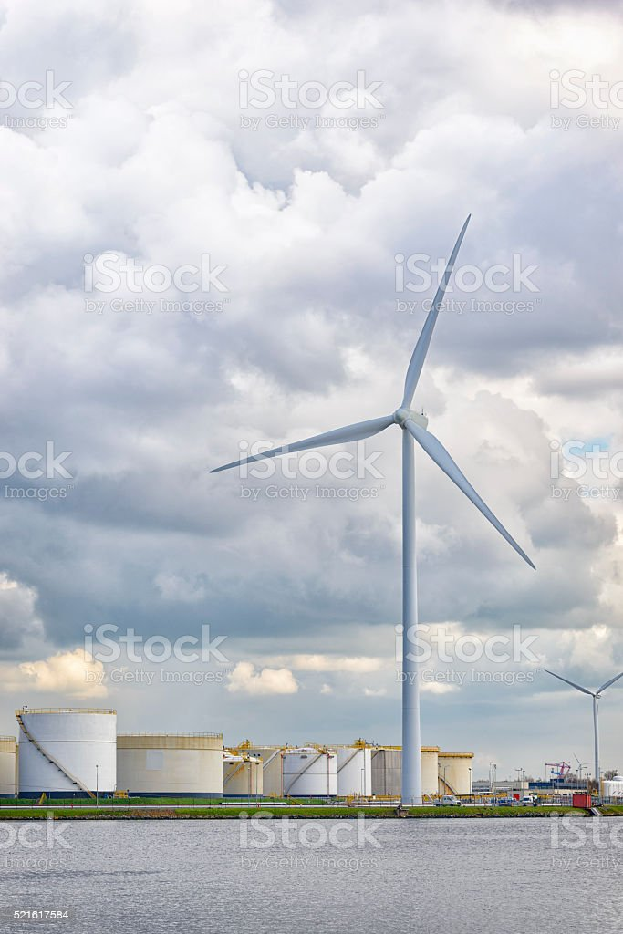 Wind turbine at an oil terminal stock photo