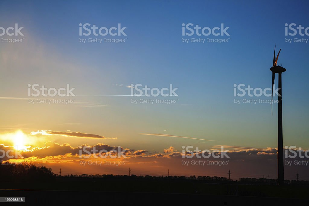 Wind turbine at sunrise stock photo