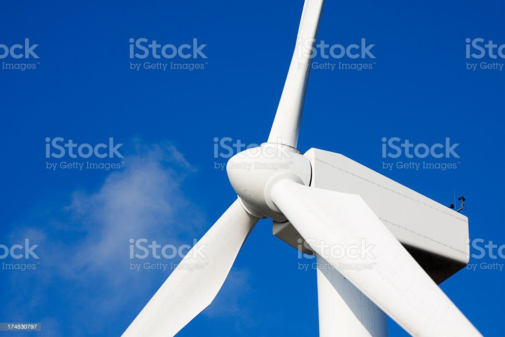 Wind turbine. Beautiful blue sky and white clouds. royalty-free stock photo