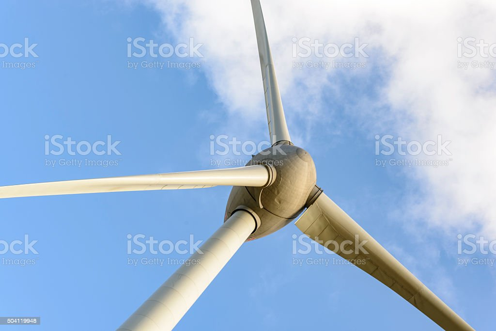 Wind turbine close up with sky and a cloud stock photo