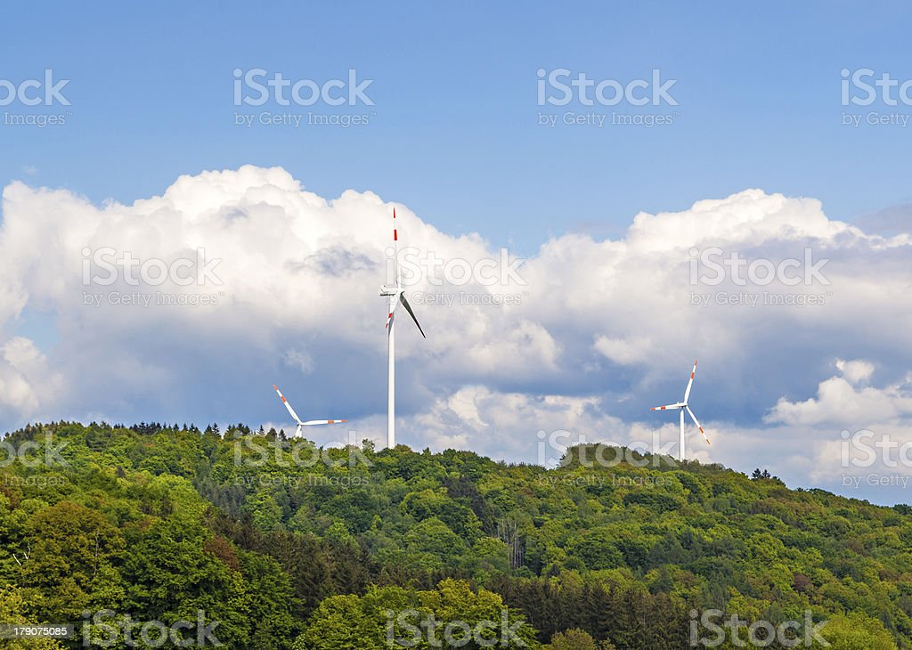 wind turbine generating electricity on blue sky royalty-free stock photo