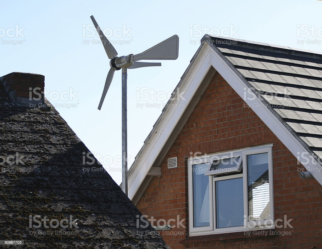 Wind turbine generator on house roof royalty-free stock photo