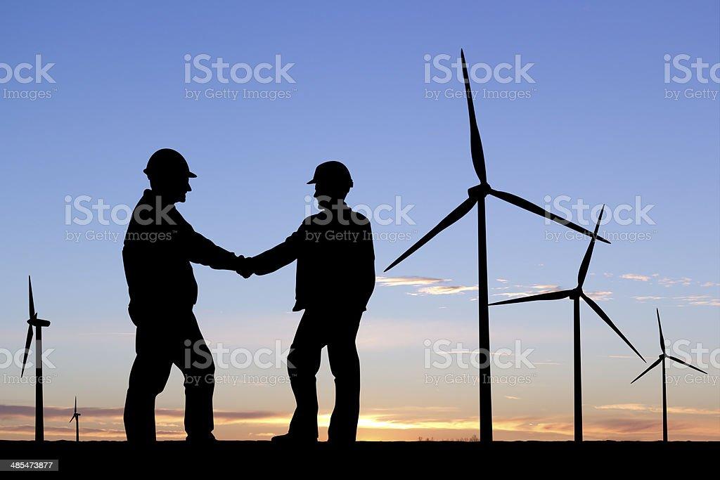 Wind Turbine Handshake royalty-free stock photo