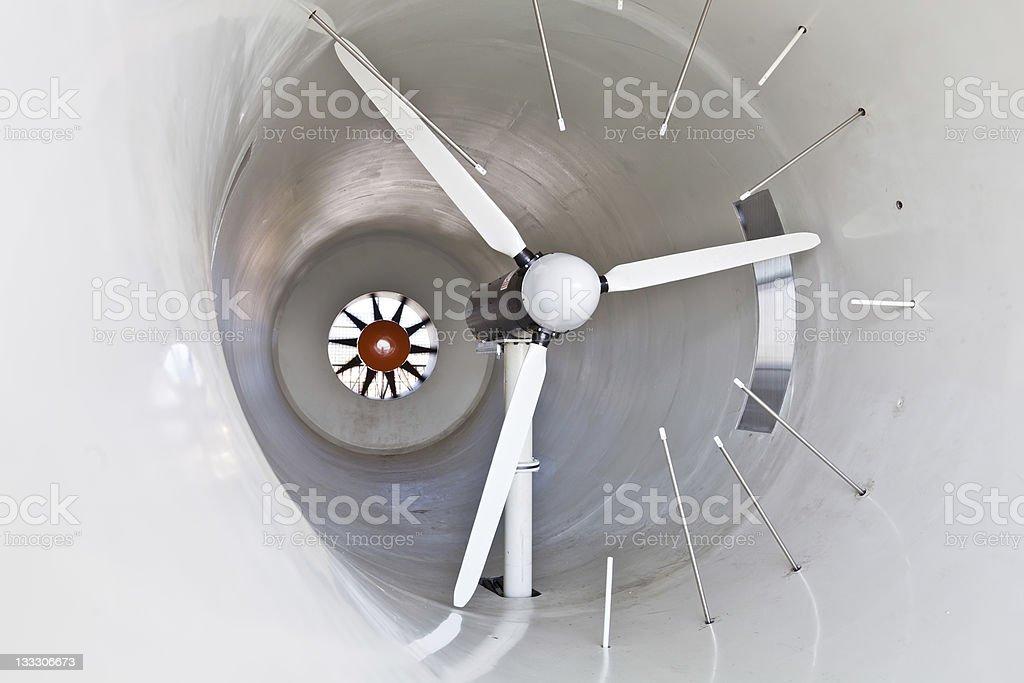 Wind turbine in a windtunnel stock photo