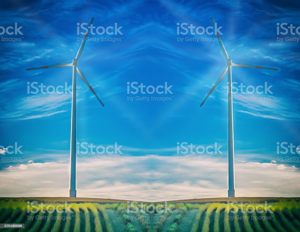 Wind turbine in abstract blue sky. stock photo