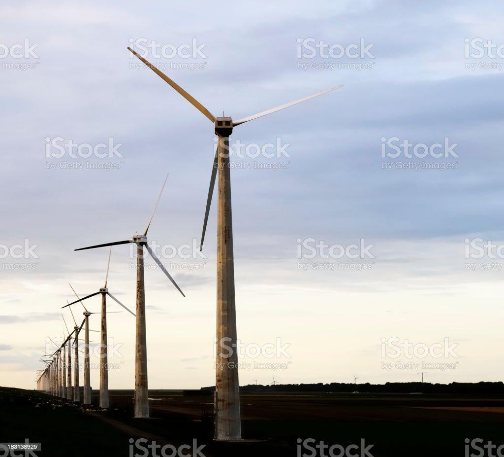 wind turbine in sunset stock photo
