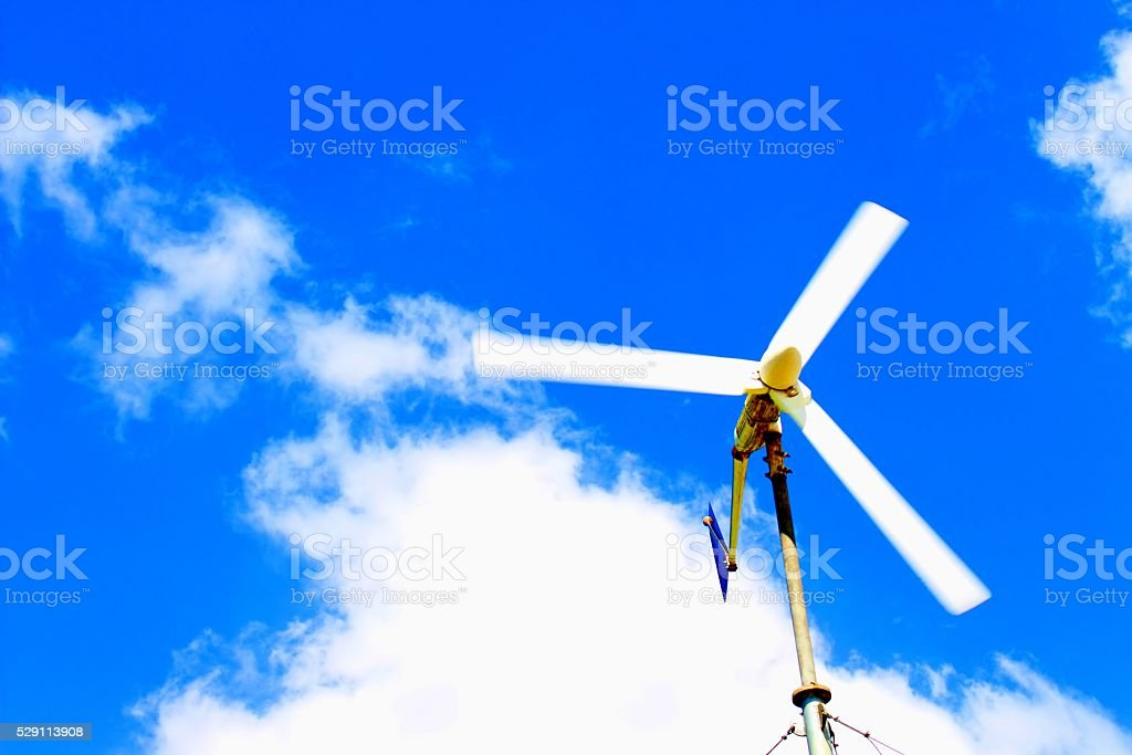Wind turbine in the blue sky stock photo