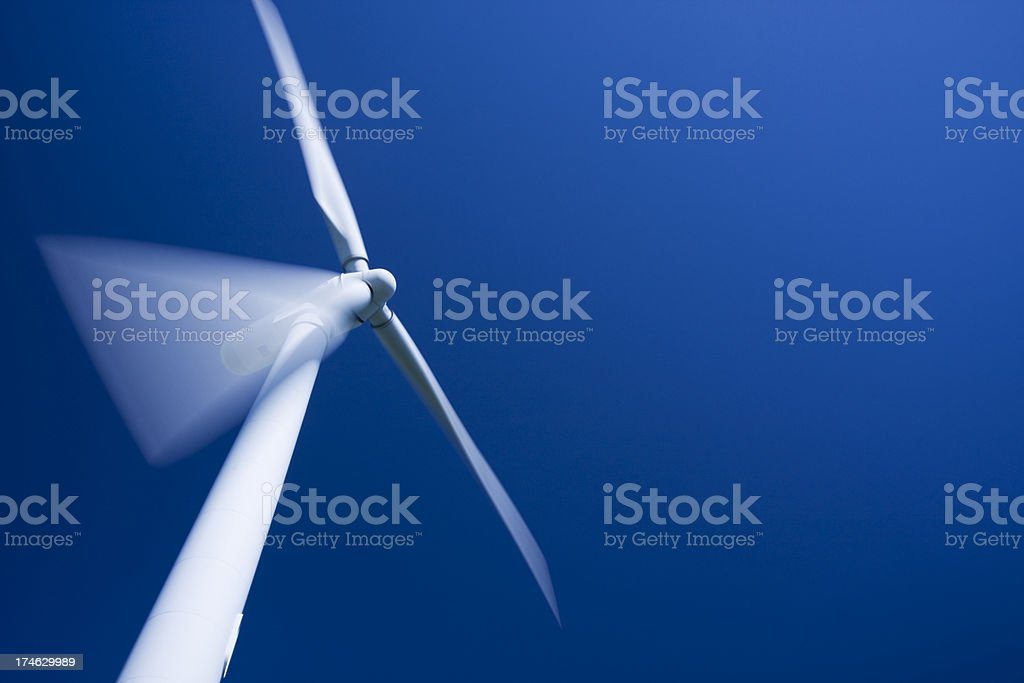 Wind turbine, motion blur and tungsten processed. Copy space. stock photo